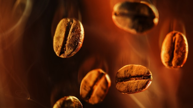 Closeup of coffee beans floating in the smoke Premium Photo