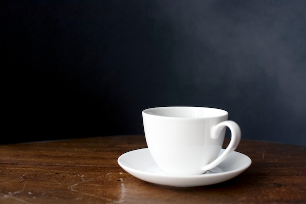 Closeup of coffee cup on wooden table Free Photo