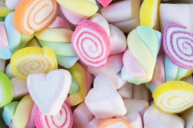 Closeup of colorful mini marshmallows with candy background or texture. Premium Photo