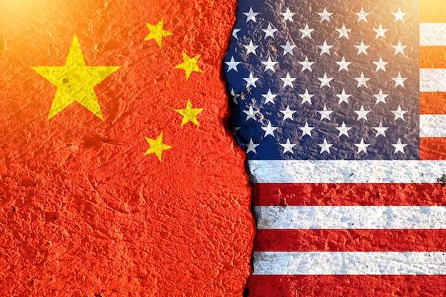 Closeup crack of usa flag and china flag Premium Photo