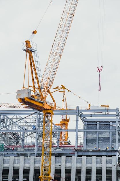 Closeup crane hoist construction on white sky background. Premium Photo