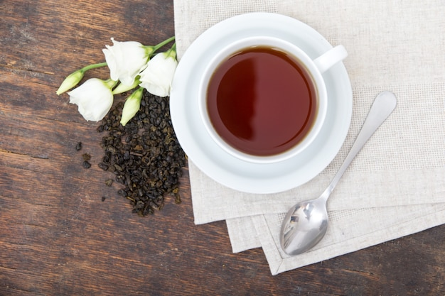 Closeup of cup of tea with beans and flowers Premium Photo