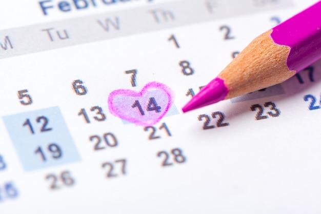 Closeup of dates on calendar page Premium Photo