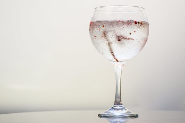 Closeup of a drink in a glass under the lights against a white background Free Photo