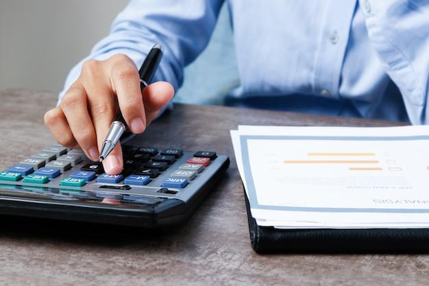 Closeup of economist using calculator Free Photo