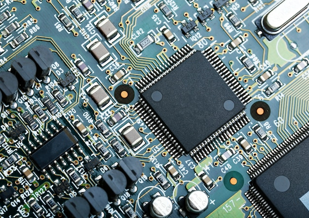 Closeup of electronic circuit board with cpu microchip electronic components background Free Photo