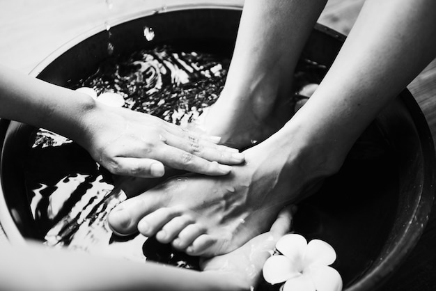 Closeup offeet spa therapy and massage Free Photo