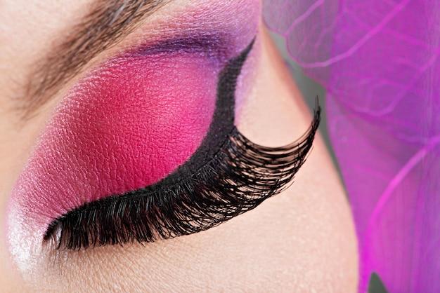 Closeup female eye with  beautiful fashion bright pink makeup Free Photo