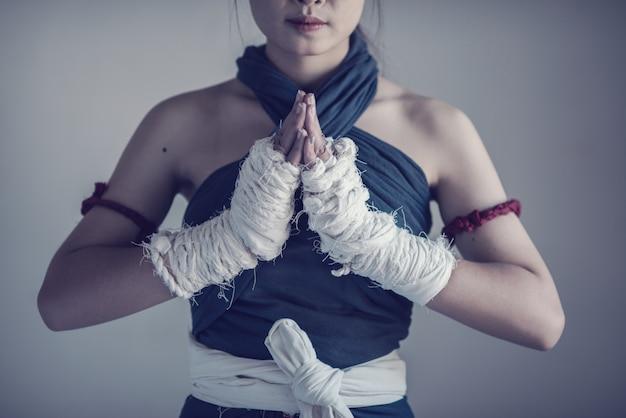 Closeup female hand of boxer with white boxing bandages. Premium Photo