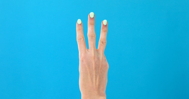 Closeup female hand counting from 3 Premium Photo