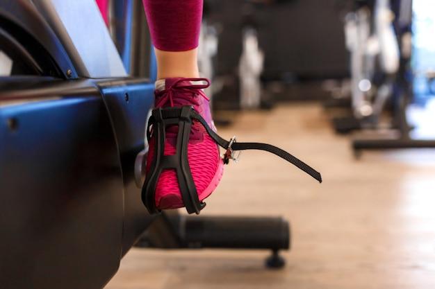 Closeup female leg in pedal of exercise bike Premium Photo