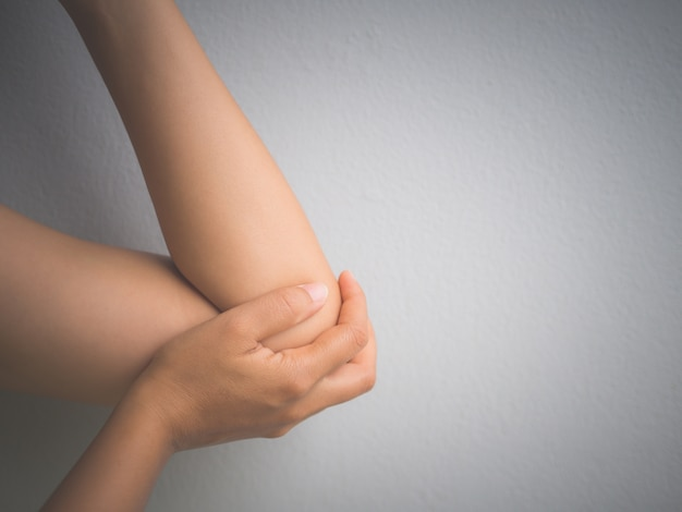 Closeup female's elbow. arm pain and injury. health care and medical concept Premium Photo