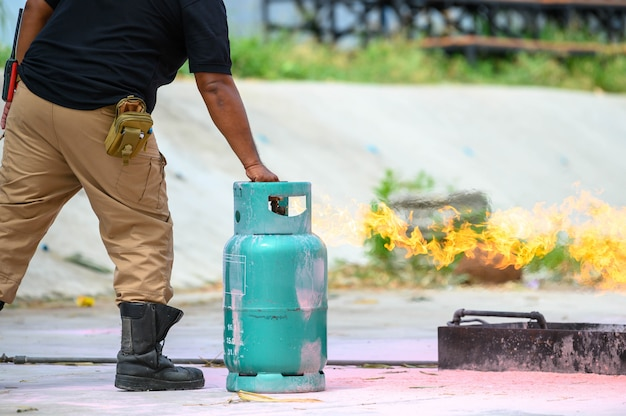 Closeup of firefighters lower body training for fire drill by demonstrate how to close gas Premium Photo