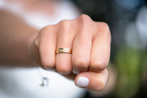 Free Photo Closeup Of The Fist Of A Woman With A Wedding Ring On Her Ring Finger