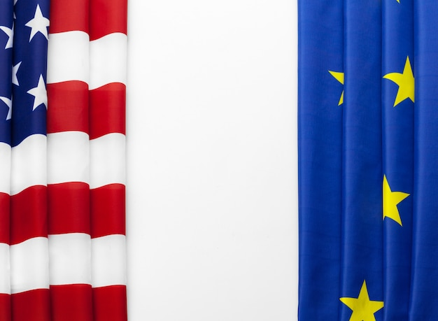 Closeup of flags of usa and european union lying together on table Premium Photo