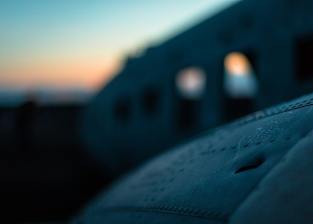 A closeup focused shot of a wing of a crashed airplane Free Photo