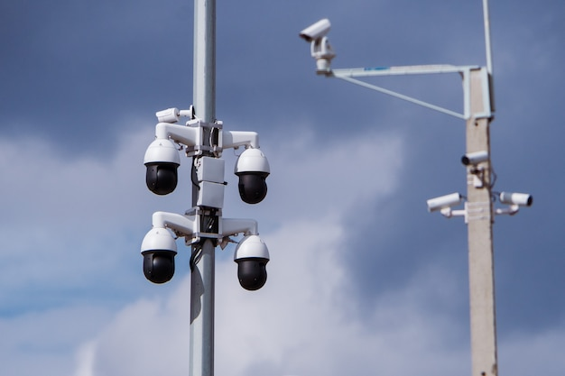 Closeup of four traffic security camera surveillance cctv on the road in thecity Premium Photo