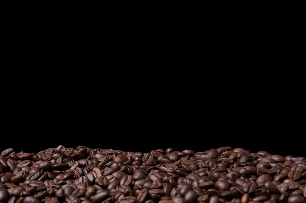 Closeup fresh coffee bean background with copyspace Premium Photo