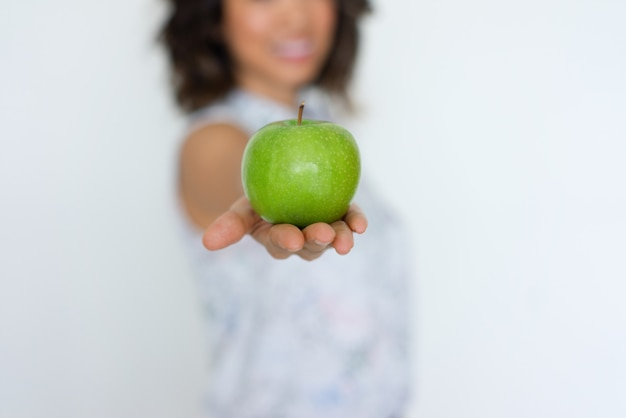 Closeup of fresh green apple on woman hand Free Photo