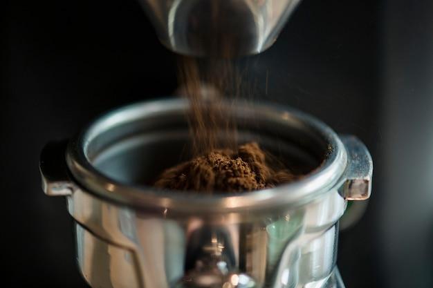 Closeup of fresh grinding coffee Free Photo