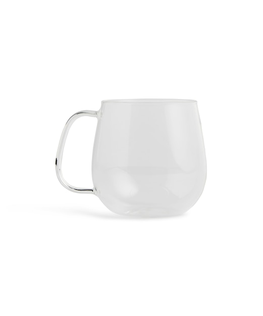 Closeup of a glass cup under the lights isolated Free Photo