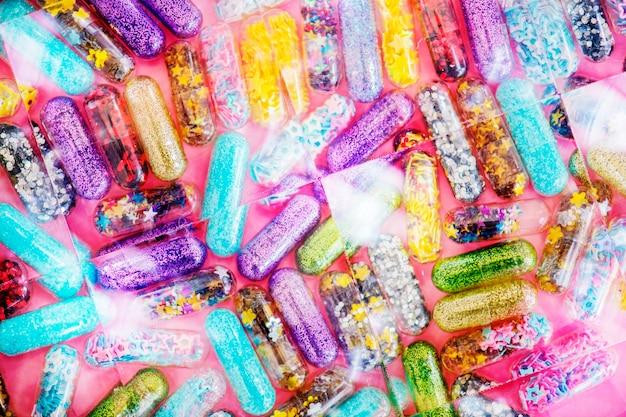 Closeup of glittery shimmery shiny pills capsule background Free Photo