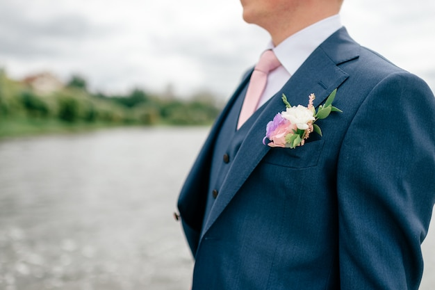 Closeup of groom in blue suit Premium Photo