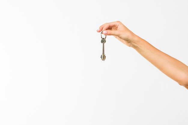 Closeup hand holding a key with copy-space Premium Photo