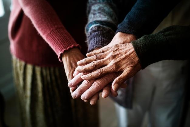 Closeup of hands of group of seniors Premium Photo