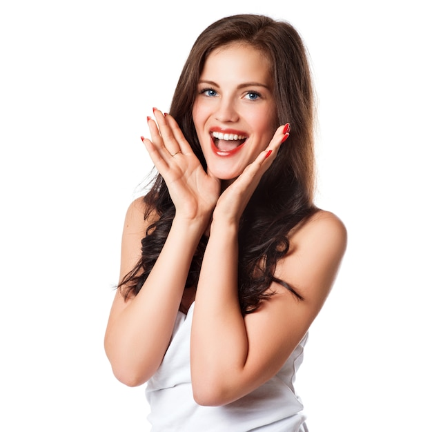 Closeup of a happy young woman surprised Premium Photo