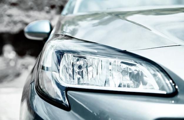 Closeup headlights of gray car Free Photo