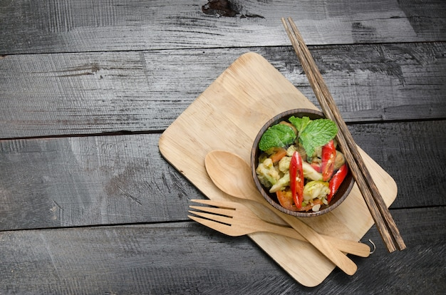 Closeup, healthy broccoli stir fry in cup wooden Premium Photo