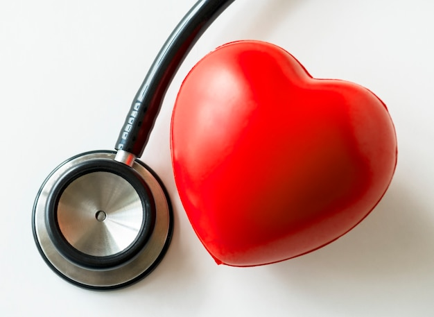 Closeup of heart and a stethoscope cardiovascular checkup concept Free Photo
