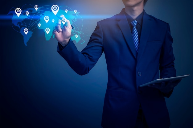 Closeup image of businessman mapping global position with tablet Premium Photo
