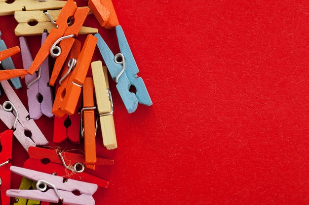 Closeup image of colorful office clothespins Free Photo
