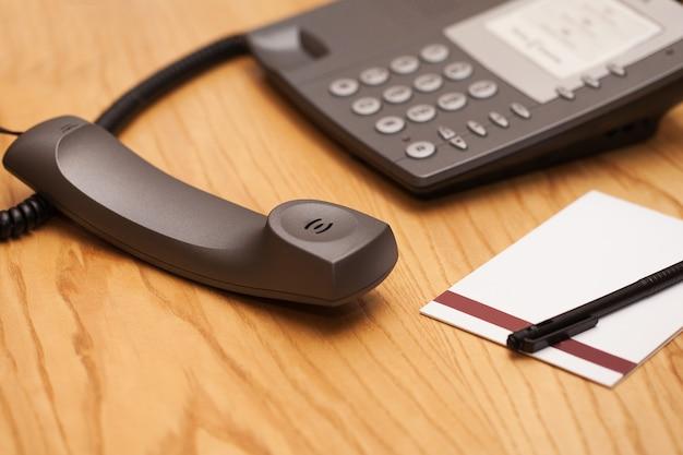Closeup image of office phone Free Photo