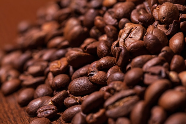 Closeup image of roasted coffee grains Free Photo