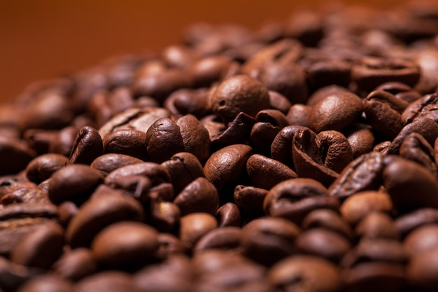 Closeup image of roasted coffee grains Free Photo