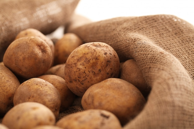 Closeup image of a rustic unpeeled potatoes Free Photo