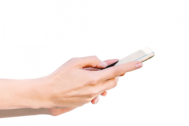 Closeup isolate, phone in female hands. white background. Premium Photo
