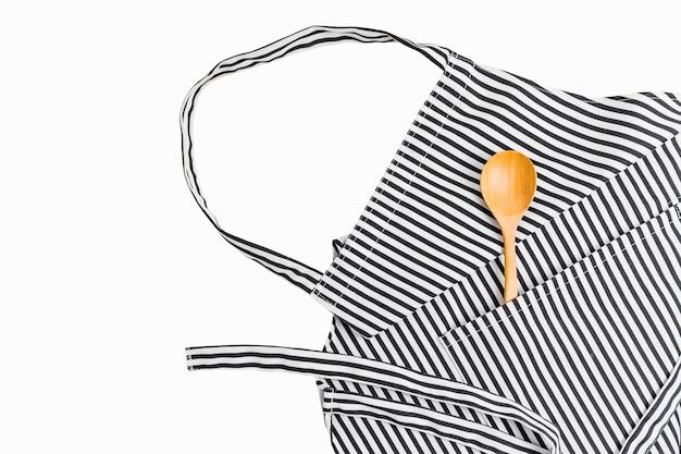 Closeup of kitchen utensils in pocket of apron Premium Photo