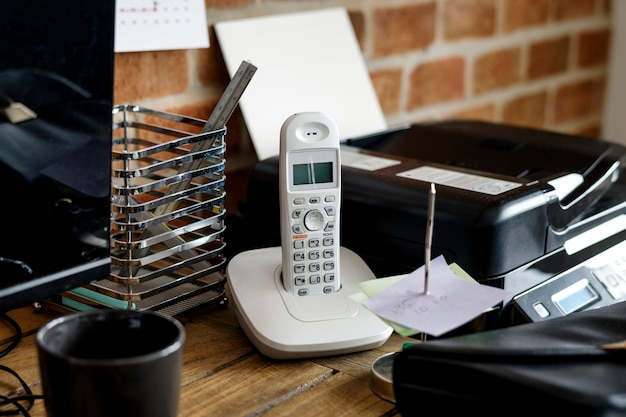 Closeup of landline phone on wooden table Free Photo