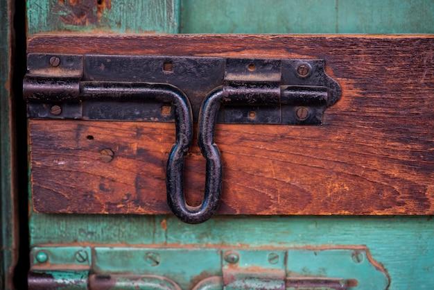 Closeup of latch door look on wooden door Free Photo