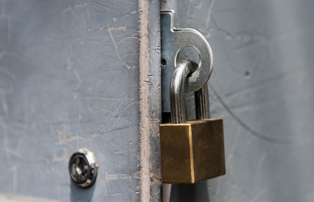 Closeup of a locked padlock Free Photo