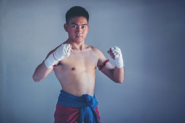 Closeup male hand of boxer with white boxing bandages. Premium Photo