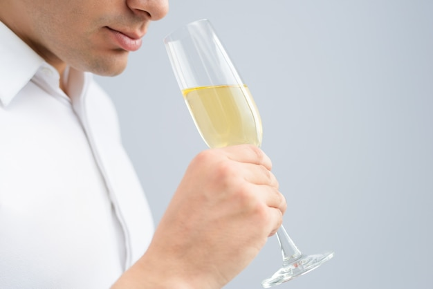 Closeup of man drinking champagne from goblet Free Photo