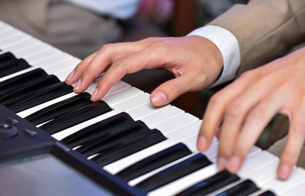 Closeup man hand playing piano on wedding or concert Photo