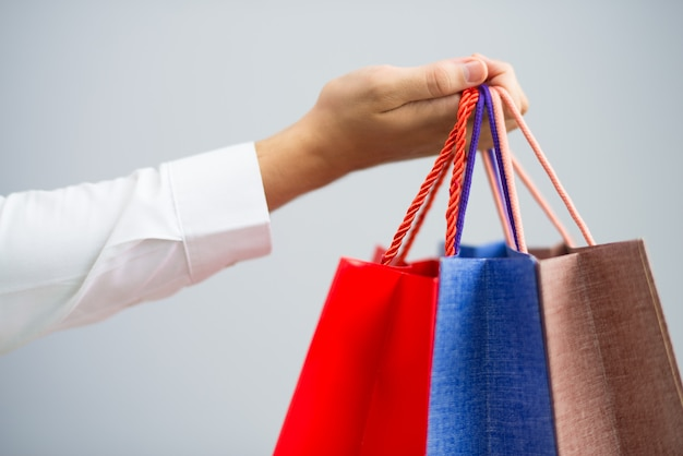 Closeup of man holding shopping bags Free Photo