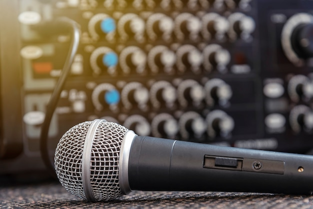 Closeup microphone with blurred sound mixer background. Premium Photo