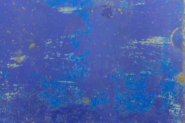 Крупный план, который слезли голубой текстуры стены. фон вид сверху Premium Фотографии